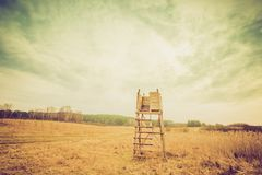 Vintage landscape with raised hide. Polish early springtime landscape Royalty Free Stock Images