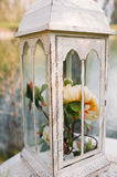 Vintage lantern with beautiful flowers close-up Royalty Free Stock Image