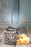 Vintage lantern and bouquet of yellow carnations Stock Photo