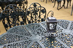Vintage lantern. With chairs and table, outdoor Stock Images