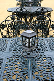 Vintage lantern. With chairs and table, outdoor Stock Photos