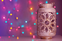 Vintage lantern on colorful background with lights Stock Photography