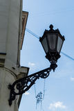Vintage lantern on the granite wall. Paris architecture.  Stock Images