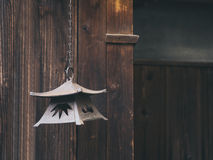 Vintage Lantern hang with Wooden Background Japan Traditional Stock Photo