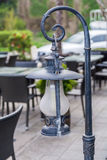 Vintage lantern isolated over blurry reastaurant terrace background Royalty Free Stock Photo