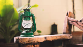 Vintage lantern lamp on wooden outdoor Stock Image