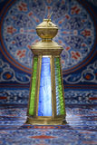 Vintage Lantern over Ramadan Fabric Royalty Free Stock Photography