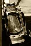 Vintage Lantern in Sepia. Closeup of a vintage lantern hanging on an authentic old west style chuck wagon (sepia tint Stock Photos