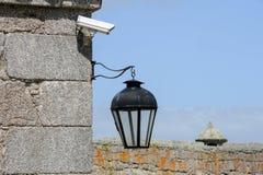 Vintage lantern and video surveillance at Santa Teresa colonial Stock Photo