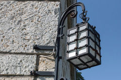 Vintage lantern. On the wall of Hungarian house Stock Photos