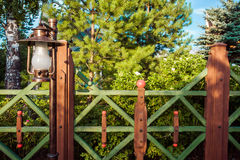 Vintage lantern and wooden fence. In garden at country side royalty free stock photo