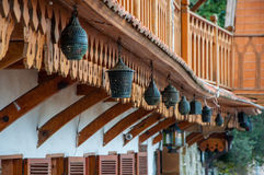 Vintage lanterns hanging on a wooden balcony in the long term Stock Photo