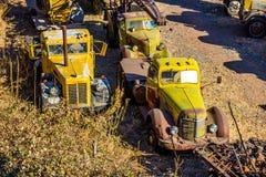 Vintage Large Trucks In Salvage Yard. Vintage Large Rusted Trucks In Desert Salvage Yard Royalty Free Stock Photography
