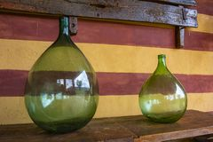 Vintage large wine bottles. Wine cellar, storage of wine. Italy stock image