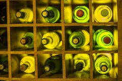 Vintage large wine bottles. Wine cellar, storage of wine. Yellow color stock images