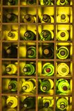 Vintage large wine bottles. Wine cellar, storage of wine. Yellow color stock photography