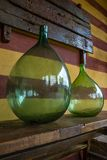 Vintage large wine bottles. Wine cellar, storage of wine. Italy royalty free stock images