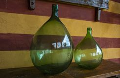 Vintage large wine bottles. Wine cellar, storage of wine. Italy stock photos