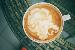Vintage latte art coffee Royalty Free Stock Images