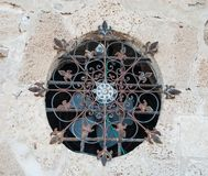 Vintage lattice. Beautiful wrought-iron lattice that adorns one of the oldest buildings of Jaffa royalty free stock photography