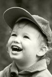 Vintage laughing kid. The carefree dared laughing boy Stock Photo