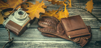 Vintage leather accessories on wooden background Royalty Free Stock Photography