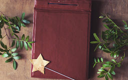 Vintage leather album and star wand background Stock Image