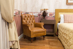Vintage leather armchair. Interior of vintage leather armchair in bedroom vintage style Royalty Free Stock Image