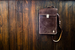 Vintage leather bag on wooden background Stock Photo