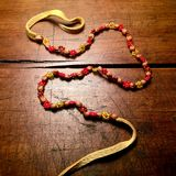 Vintage leather, beads and seeds necklace. Royalty Free Stock Photography
