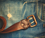 Vintage leather belt on old jeans Royalty Free Stock Photos