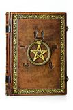 Vintage leather book with gilded ouroboros, pentagram and embossed five elements symbols on the ancient Egyptian. The book stand up to the table and it is stock images