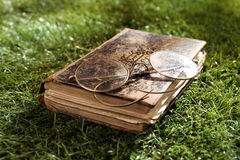 Vintage leather book and spectacles Stock Image