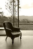Vintage leather chair in room, sepia processed Royalty Free Stock Photos
