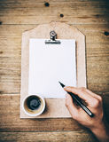 Vintage leather clipboard with blank page and hand Royalty Free Stock Photography