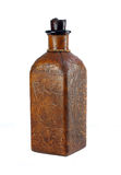 Vintage Leather Liquor Bottle. One vintage leather covered decorative liquor bottle on white Royalty Free Stock Images