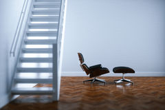 Vintage leather lounge chair in new white interior room with woo. Den floor and stairs 3D render Royalty Free Stock Images