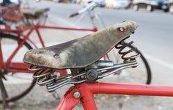 Vintage leather old bike saddle Stock Photo
