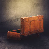 Vintage Leather Retro Luggage Suitcase Open. Vintage Leather Luggage Suitcase Open Ready For Packing in Concrete Room, Rear Side View, Retro Toned Effect Royalty Free Stock Images