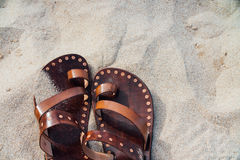 Vintage leather sandals handmade on the sand. Nobody.  Royalty Free Stock Photo