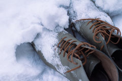 Vintage leather shoes covered in snow Royalty Free Stock Photos