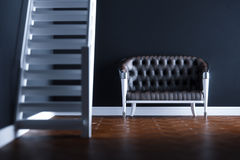 Vintage leather sofa in new black interior on wooden parquet flo. Or 3D render version 2 Royalty Free Stock Image
