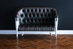 Vintage leather sofa in new black interior on wooden parquet flo. Or 3D render version 1 Royalty Free Stock Photography
