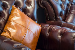 Vintage leather sofa and pillows Stock Images