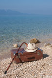 Vintage Leather suitcase on the beach Stock Photos