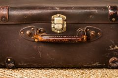 A vintage leather suitcase on a esparto carpet. In a close up view royalty free stock photos