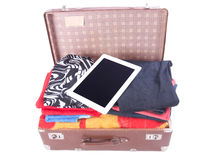 Vintage leather suitcase overstuffed with Tablet gadget Stock Images