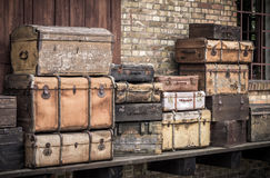 Vintage leather suitcases stacked vertically - Spreewald, Germany. stock photos