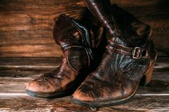 Vintage leather women`s boots on rustic wooden background. Vintage leather women`s boots on rustic background stock photos