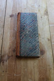 Vintage ledger with marbleized paper cover Royalty Free Stock Photography